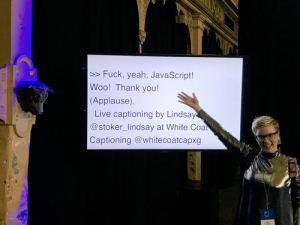 Unn points to one of the screens used to display the captions